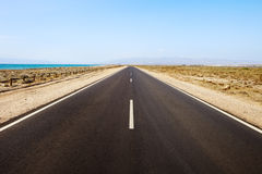 Straight road in desertic seascape. Andalusia. stock image
