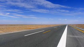 Straight  road in the gobi Stock Photo