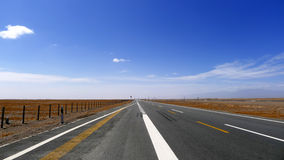Straight  road in the gobi Stock Photos