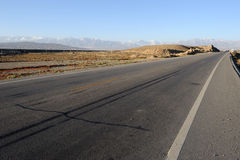Straight  road in the gobi Royalty Free Stock Photos