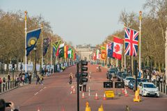 The straight road, The Mall with many countries flags. London, APR 14: The straight road, The Mall with many countries flags on APR 14, 2018 at London, United Royalty Free Stock Photos