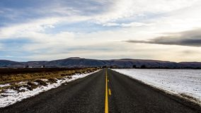 Straight road with melting snow Stock Photography