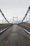 Straight road and metallic bridge in Iceland Stock Photo