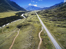 Straight road in mountain Stock Images