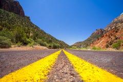 Straight road through mountainous area. Utah, USA Stock Image