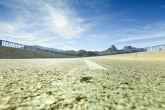 Straight on a road between mountains with the sun in front. Leon. Spain Stock Image