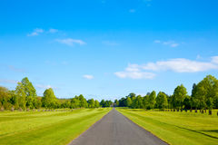 Straight road. Straight park road in England Stock Photography