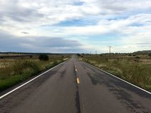 Straight Road in the Plains of Colorado stock images