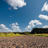 Straight road in rural landscape Stock Photo