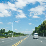 Straight road. And sky in the city Royalty Free Stock Images