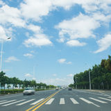 Straight road. And sky in the city Royalty Free Stock Image