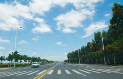 Straight road. And sky in the city Royalty Free Stock Photography
