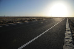 Straight  road at sunrise. Straight  road in the gobi at sunrise,located in Inner Mongolia Ejinaqi, China Royalty Free Stock Images