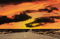 Road at the sunset. Straight road at sunset in rural Parque National De Las Canadas.Islands of Tenerife Royalty Free Stock Photography