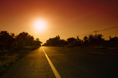 Straight Road at sunset in rural Thailand.  Royalty Free Stock Photo