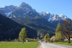 Straight road to the mountains Stock Photos