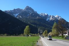 Straight road to the mountains Royalty Free Stock Images
