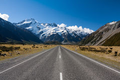 Straight road to the mountains Royalty Free Stock Photography