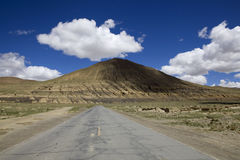 Straight road to the mountains. The straight road to the mountains in Tibet of China Stock Photography