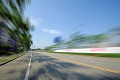 Straight road under blue sky Stock Photography