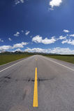 Straight road under blue sky Royalty Free Stock Images