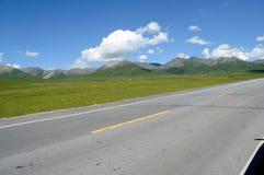 Straight road under blue sky Stock Photo