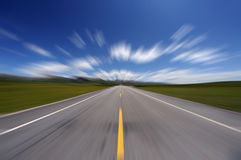 Straight road under blue sky. Asphalt straight road, motion blur Stock Image