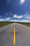 Straight road under blue sky Royalty Free Stock Photography