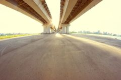 Straight road under the bridge. Freedom and travel concept Stock Images