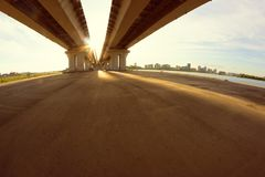 Straight road under the bridge. Freedom and travel concept Stock Photos
