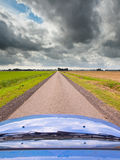 Straight Road under Brooding Sky Stock Image