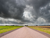 Straight Road under Brooding Sky Stock Photography