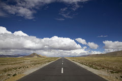 Straight road. The straight road under white cloud in Tibet of China Stock Image