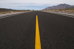 Straight road vanishing into distance Stock Photos