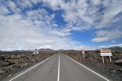 Straight road through the volcanic field. Stock Photography