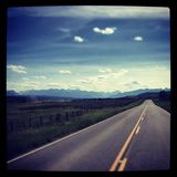 Straight rood to the rocky mountains. With instagram effect Royalty Free Stock Image