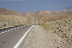Straight route in Iran. Straight mountain route in Iran. Summer day - Desert Stock Photography