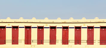 A straight row of locked doors, background Royalty Free Stock Image