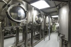 Straight rows of tanks of stainless steel, modern production of alcoholic beverages. stock photo