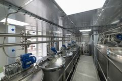 Straight rows of tanks of stainless steel, modern production of alcoholic beverages. Food industry stock photos