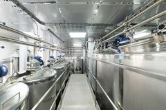 Straight rows of tanks of stainless steel, modern production of alcoholic beverages. royalty free stock photos