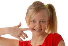 Straight teeth. Portrait of a little blonde with a bracket on the teeth Stock Photography