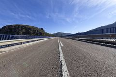 Straight to infinity of a spanish highway on a sunny day Royalty Free Stock Images