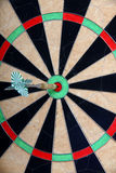Straight To The Target. Arrow On Darts Board Royalty Free Stock Photos