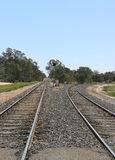 Straight and turning railway tracks Royalty Free Stock Photo