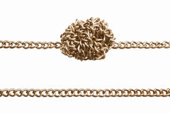 Straight and twisted chain. Straight and twisted golden chain in parallel,  isolated against white background Royalty Free Stock Photography