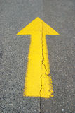 Straight up arrow. Straight up yellow painted arrow on asphalt street Stock Photography
