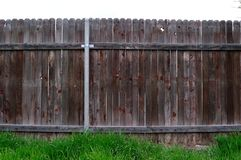 Straight view of old wooden fence between neighbors stock photos