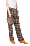 Straight wide plaid pants and stingy brim hat royalty free stock images