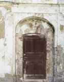 Straight wooden door in a aslope wall Stock Photo